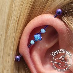 Here's a custom Anatometal industrial barbell that we had made for one of our lovely clients! Healed piercing was not done by us! Loving the beautiful blue and blurple! @anatometalinc #piercing #piercings #safepiercing #internalthreadtitanium...