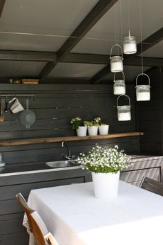 outdoor kitchen. clean and simple. dark gray painted wood. horizontal lines.