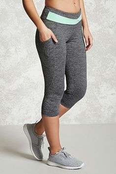 A pair of knit athletic capri leggings featuring a contrast panel on the waist, side sheer mesh pockets, a hidden key pocket, and moisture management. Womens Workout Outfits, Sport Outfits, Cool Outfits, Workout Leggings, Women's Leggings, Capri Leggings, Grey Sports Leggings, Yoga Pants Outfit, Cute Pants
