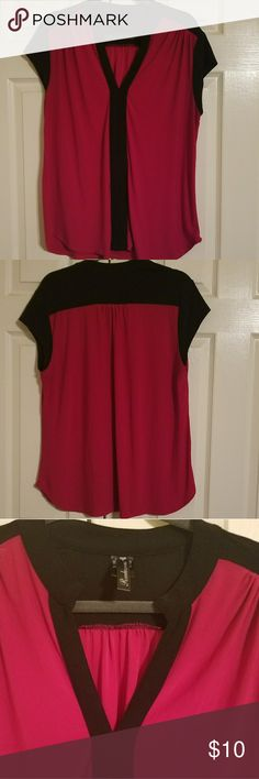 Rendezvous brand beautiful blouse This blouse is amassing, pretty and loose fitting. It's fuscia and black. Rounded hemline. Barely worn. RENDEZVOUS Tops Blouses