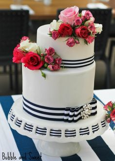 Navy stripe and pink rose cake with pearl detail for a delightful afternoon tea party