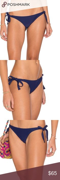 LOVERS + FRIENDS Navy Ties Bikini Bottoms Lovers + Friend exudes ease and wearability that creates an effortlessly chic look! I just love these bikini bottoms! Spandex blend Hand wash cold Ties at sides Color - Navy Lovers + Friends Swim Bikinis