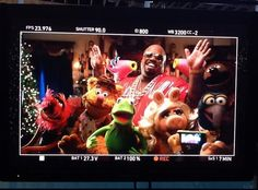 This is what it looks like when CeeLo and the Muppets shoot a video for their holiday single, All I Need Is Love!