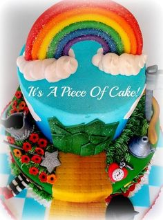 This is an awesome Wizard of Oz cake!! I love the corny joke that goes with it too. :-).  Love the rainbow on this one
