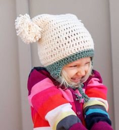 """Free Beginner Crochet Beanie Hat Pattern """"Pom Pom Party"""" This free crochet beanie pattern is perfect for beginners because the skills involved aren't much harder than making a s. Newborn Crochet Hat Pattern, Crochet Toddler Hat, Childrens Crochet Hats, Easy Crochet Hat, Crochet Beanie Hat, Chunky Crochet, Crochet Baby Hats, Free Crochet, Crochet Patterns"""