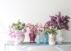 Pretty flowers and vintage vases.