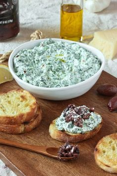 Recipe: Spinach and Ricotta Crostini with Kalamata Olives — Recipe from The Kitchn Sponsored by ALDI Appetizer Recipes, Snack Recipes, Cooking Recipes, Appetizers, Halal Recipes, Holiday Recipes, Great Recipes, Favorite Recipes, Dressings