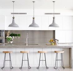 Minimalist white kitchen with wood and grey industrial accents