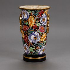 Boch Freres Art Deco Vase Designed by Raymond Chevalier  --  Boch Freres circa 1930s tall vase with vibrant floral glaze and gilt details designed by Raymond Chevalier.  --   Item:  6089  --  Retail Price:   $995