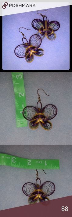 Butterfly quilled earrings Fly away with these pretty butterfly earrings. Handmade with a quilling technique. Lightweight and fun. Jewelry Earrings