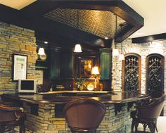 Wood bar top with corbels, beamed ceiling has metal inset.