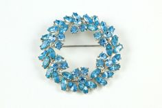 """This beautiful vintage Trifari brooch circa 1950s features striking aqua blue marquis and round rhinestones.  It is in very good condition and has all stones.  Measures approximately 2""""L x 2""""W."""