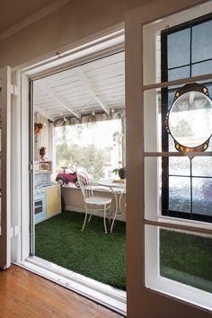 Jeremy & Kim's Cozy Deco Home- astroturf porch