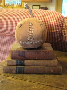 Pumpkin with early leather books.