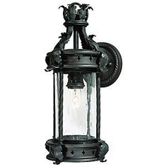 Los Feliz Outdoor Wall Mount by Troy Lighting by Troy Lighting, Inc.. $294.00. Ole! Give the home a Spanish flair with the Troy Lighting Los Feliz Outdoor Wall Mount. Featuring hand-forged iron flourishes and clear seeded glass, this wall sconce brings a bit of Spanish passion and luxury to the exterior of the home. Finished in Old Bronze. Troy Lighting, headquartered in California, designs and manufactures indoor and outdoor lighting fixtures, utilizing hand-forged iron...