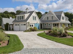 New Cape Cod Home - farmhouse - Exterior - Boston - Encore Construction  LIke the idea of a rolling door for the lawn mower storage...