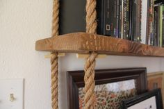 DIY amazing rope shelving! want this on the side of the TV to display our movie collection