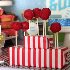 use floral foam wrapped in wrapping paper as cake pop stands