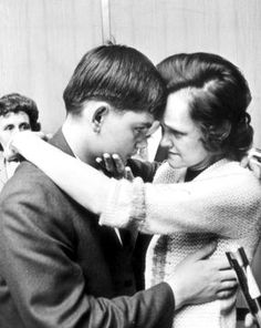 Gertrude Baniszewski and son John, 13, say goodbye following the trial for the murder of Sylvia Likens. Baniszewski brutally tortured and murdered Likens in her home until she eventually died of brain hemorrhage.
