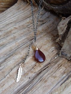 feather and teardrop by jeweldesignsbyred on Etsy, $27.00