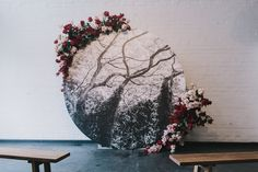 Ceremony backdrop, altar, arbour designed and styled by Nomad Styling. Circular backdrop for wedding ceremony with beautiful florals.