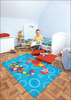 Add a bunch of colour with the playful Arte Espina Designer Kids Sea Horses Rug Blue