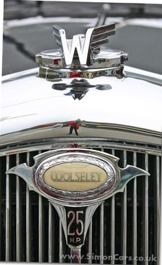 Wolseley's radiator cap and trademark illuminated grill logo Retro Cars, Vintage Cars, Antique Cars, Car Badges, Car Logos, Black Tv Unit, Car Symbols, Grill Logo, Car Hood Ornaments
