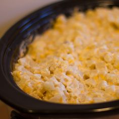CROCK POT HASH BROWN CASSEROLE  1 large package of frozen hash browns (about 2 lbs or 1 kg)  1 can cream of mushroom soup  2 cups sour cream (500ml tub)  1 onion, minced  2 cups grated cheddar cheese  1 tsp salt  ½ tsp pepper  Instructions  Mix all ingredients together and dump in a Crock Pot slow cooker.  Cook on low for 8 hours.