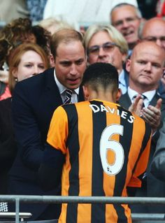 Losing captain Curtis Davies of Hull City shakes hands with Prince William, Duke of Cambridge after the FA Cup with Budweiser Final match between Arsenal and Hull City at Wembley Stadium, 17.05.2014 in London, England.