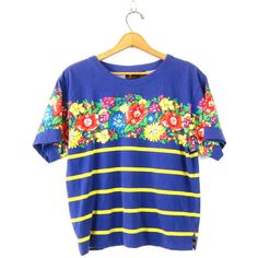 Purple TShirt FLOWER Print tee Shirt 90s Grunge Tee retro Top Floral... ($23) ❤ liked on Polyvore featuring tops, t-shirts, graphic design t shirts, striped shirt, graphic t shirts, graphic tees and vintage graphic tees
