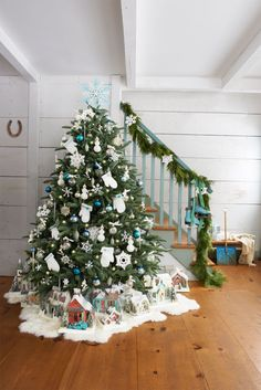 Let It Snow  - CountryLiving.com I love the sheepskin rug in lieu of a tree skirt + the Christmas village