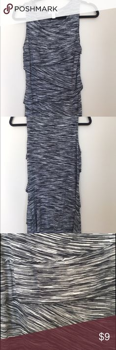 Perfect B&W tunic length layered front tank This super flattering long line tank top is a must-have layering piece. The layered front makes this top extra forgiving and very sliming. Black and white design. Worn a couple times but no visual signs of wear. Excellent condition. Tops Tank Tops