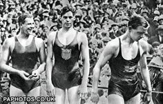 Johnny Weissmuller - ( centre) 1928 Olympics Swim costumes have changed a bit since then !