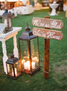 rustic lantern and wedding sign decor / http://www.deerpearlflowers.com/rustic-lantern-wedding-decor-ideas/