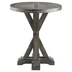 "Solid wood end table with a weathered grey finish. Product: End tableConstruction Material: Solid wood and birch veneerColor: Weathered grey Features: Plank style detailing on topUrban casual style Dimensions: 26"" H x 22"" Diameter"