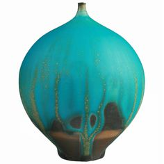 "Turquoise blue ""Feelie"" vase with wonderful and vibrant colors. The Tucson artist was very well known for thes forms. Circa 1970"
