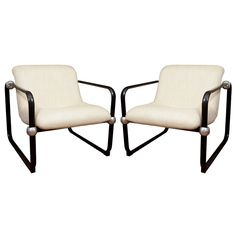 Pair of ebonized wood armchairs with steel ball detail france 1950