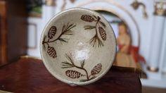 http://www.ebay.com/itm/Dollhouse-Artisan-Jane-Graber-Miniature-Pine-Cone-Stoneware-Bowl-/252196122572?hash=item3ab80f6fcc:g:8FwAAOSw7FRWXyhz