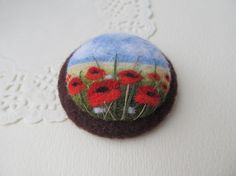 Needle felted brooch with a poppiesdecorated от FeltAccessories