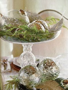 Silvery Christmas balls accented with evergreen in a wonderful glass compote.  My kind of Christmas decorating.