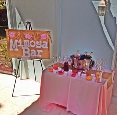 Mimosa bar - set up. Champagne & juice on display. Other champagne & juices in coolers under the table.