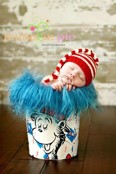 This hat on a stack of Dr. Suess Books  Originally pinned by Jackie Cue onto Newborn Photography
