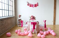 The Everygirl's Valentine's Day Soiree // pink and silver garland // heart-shaped balloons // table setting // pink and red // Hey Gorgeous Events // photography by Kelly Braman Photography