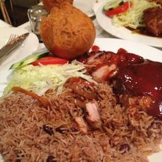 Jerk City - London, United Kingdom. Roti Jerk Chicken meal with rice and peas and side salad