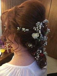 Lopes and twist hairstyle created to use fresh flowers