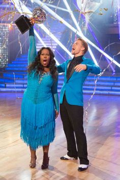 Amber Riley hoists that Dancing With the Stars mirror ball trophy high after she & Derek Hough are announced winners of season 17  -  fall 2013