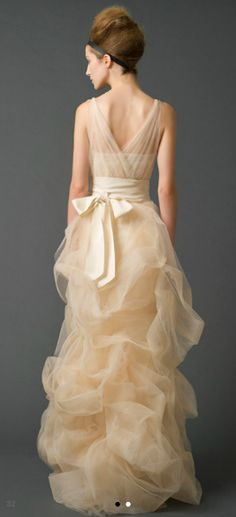 Vera Wang Fall 2011. Three piece beauty. Cream heart shape top but one shoulder transparent bring-up. Thick, silk, mono-chrome waist tie. Second, bubble gathering to add asymmetry to ruffle bottom. Color but in a matte fabric.