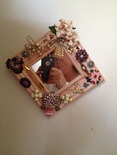 First creation using vintage pins and a repurposed mirror.