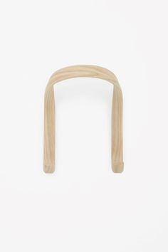 This two-prong hook is from solid ash wood that has been steamed to form a smooth, curved shape. The wall hangings sit behind the hook to hide the screws. (COS Home) Wall Hanger, Wall Hooks, Hangers, Everyday Objects, Contemporary Fashion, Innovation Design, Home Goods, Pure Products, Wall Hangings