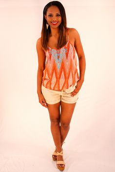 Tribal Fever Tank - Cool and comfortable in palazzo style linen pants. Perfect for a casual and relaxed stroll through downtown or while away on vacay this beach season. With a foldover band at waist these pants put a spin on a traditional spring classic. Fun paired with wedges or sandals. Try adding a fedora or straw bag to compliment the relaxed vibe. These pants are a spring staple  - available online at http://www.envyboutique.us/shop/tribal-fever-tank/ #Envy #Boutique #c